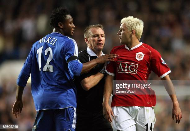 Chelsea's John Mikel exchanges words with Manchester United's Alan Smith in front of match referee Graham Poll