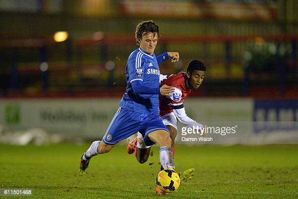 Chelsea's John Swift and Arsenal's Gedion Zelalem battle for the ball