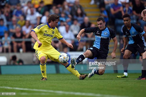Chelsea's John Swift and Wycombe Wanderers Josh Scowen during the Matt Bloomfield Testimonial match at Adams Park on 16th July 2014 in High Wycombe,...