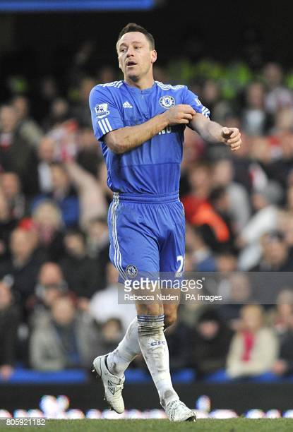 Chelsea's John Terry adjusts his captain's armband after scoring the second goal of the game