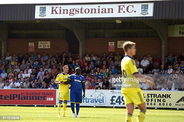 Chelsea's John Terry and AFC Wimbledon's Adebayo Akinfenwa shakes hands during the game