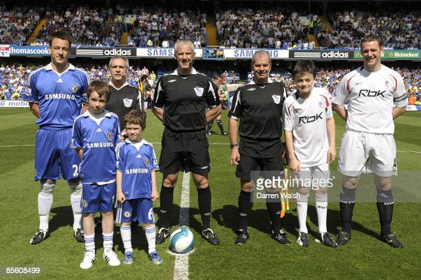Chelsea's John Terry and Bolton Wanderers' Kevin Nolan pose with referee Chris Foy before kick off