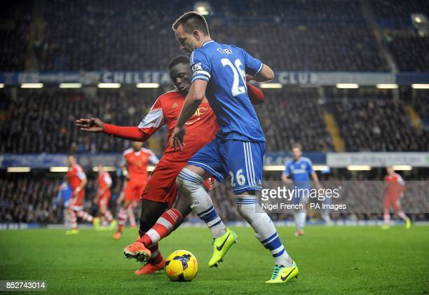 Chelsea's John Terry and Southampton's Victor Wanyama battle for the ball
