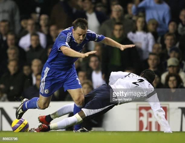 Chelsea's John Terry and Tottenham Hotspur's Pascal Chimbonda battle for the ball