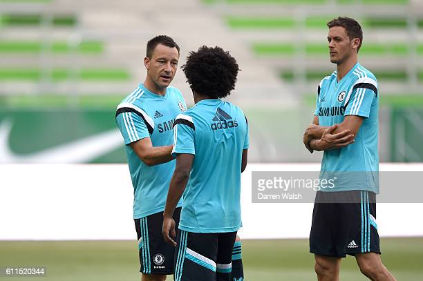 Chelsea's John Terry and Willian in conversation during training
