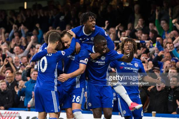 Chelsea's John Terry celebrates with team mates after scoring the opening goal during the Premier League match between Chelsea and Watford at...