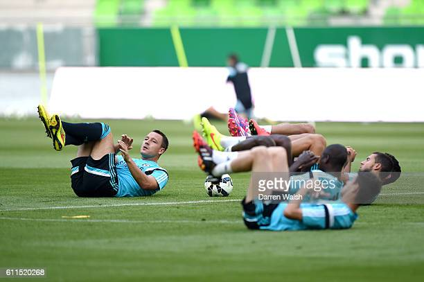 Chelsea's John Terry stretches out during training