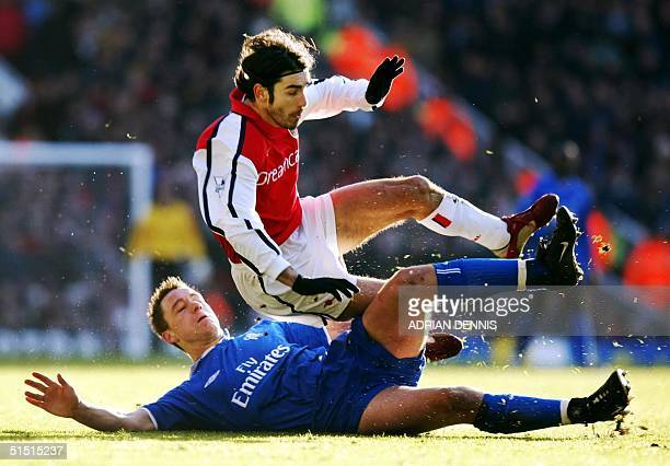 Chelsea's John Terry tackles Arsenal's French midfielder Robert Pires during the Premier League match at Highbury in London 26 December 2001. Arsenal...