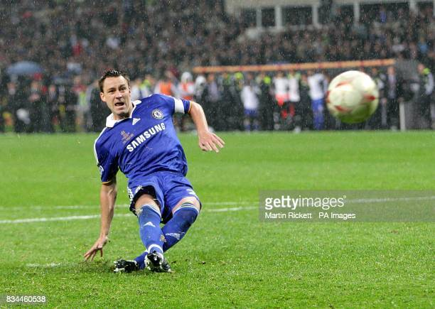 Chelsea's John Terry watches the ball as it strikes the post in the shootout
