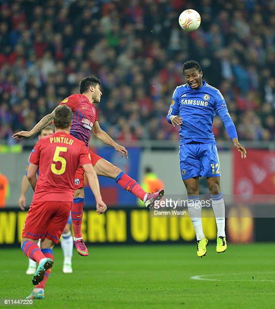 Chelsea's Jon Obi Mikel heads the ball away from danger