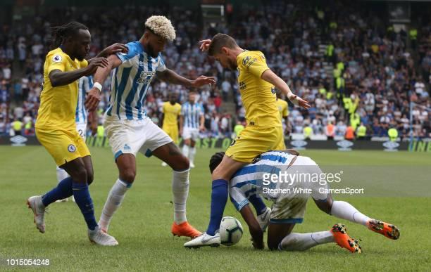 Chelsea's Jorginho battles with Huddersfield Town's Terence Kongolo during the Premier League match between Huddersfield Town and Chelsea FC at John...