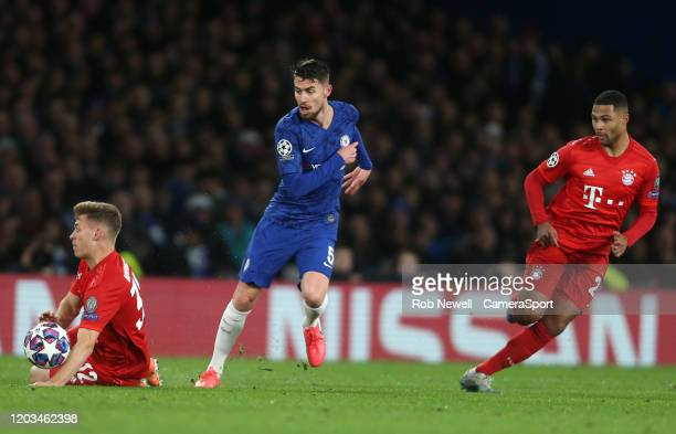 Chelsea's Jorginho gets in between Bayern Munich's Joshua Kimmich and Serge Gnabry during the UEFA Champions League round of 16 first leg match...