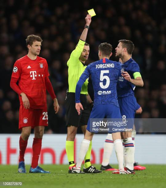 Chelsea's Jorginho receives a yellow card during the UEFA Champions League round of 16 first leg match between Chelsea FC and FC Bayern Muenchen at...