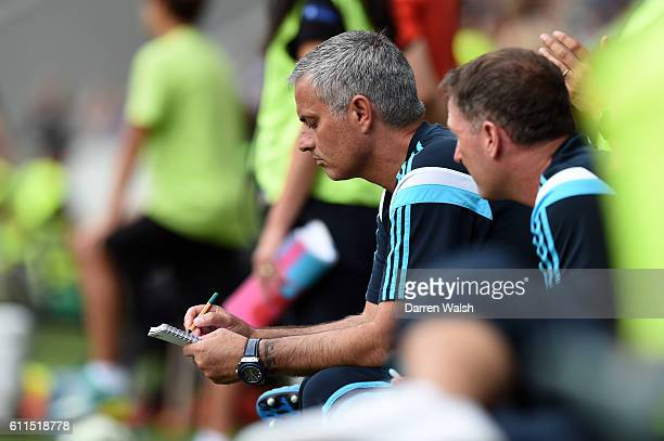 Chelsea's Jose Mourinho writing notes during a pre season friendly match between NK Olimpija Ljubljana and Chelsea FC at the Stozice Stadium on the...