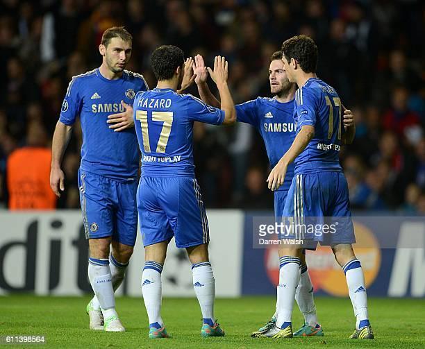 Chelsea's Juan Mata celebrates with his teammate Eden Hazard after scoring his team's third goal