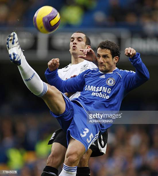 Chelsea's Juliano Belletti clears the ball in front of Everton's Leon Osman during their Premiership football match at Stamford Bridge in London 11...