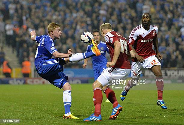 Chelsea's Kevin De Bruyne and Swindon Town's Jay McEveley battle for the ball