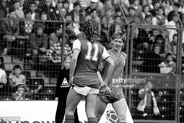 Chelsea's Kevin McAllister and Graham Rix of Arsenal