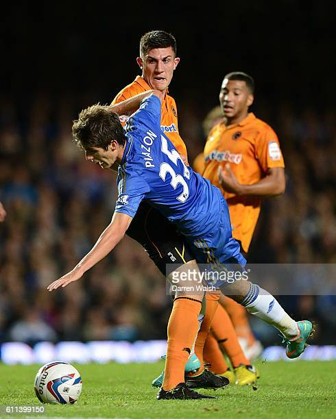 Chelsea's Lucas Piazon and Wolverhampton Wanderers' Danny Batth battle for the ball