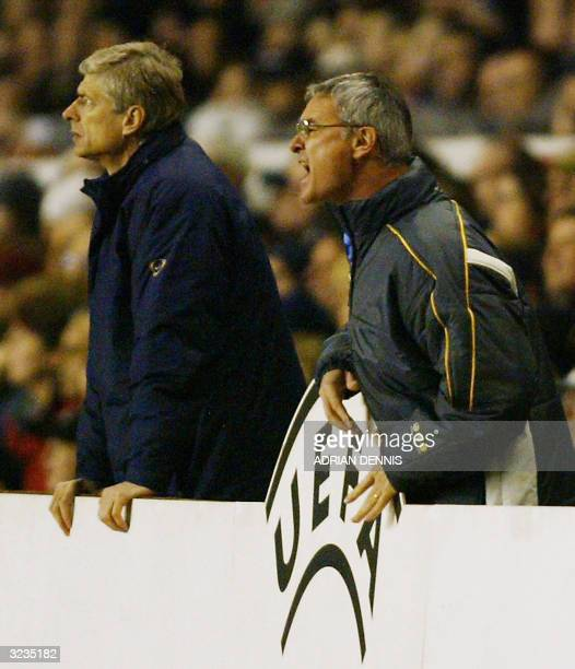 Chelsea's manager Claudio Ranieri give directions to his team as Arsenal's manager Arsene Wenger watches during their Champions League quarterfinal...