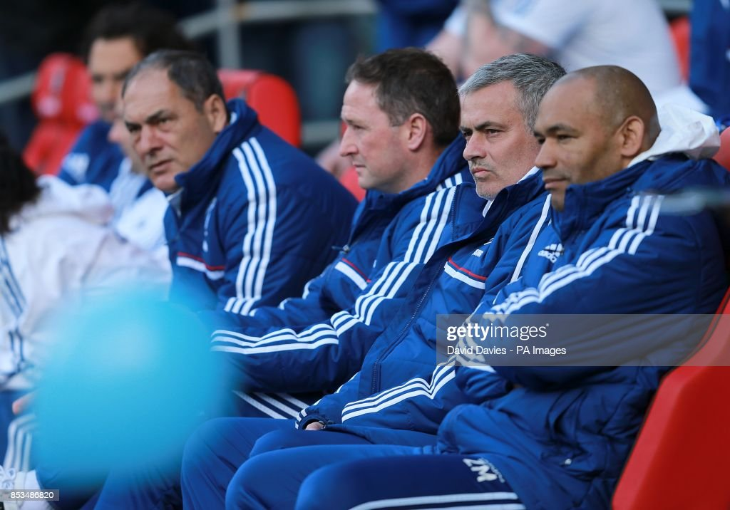 Chelsea's manager Jose Mourinho (second right), assistant manager Steve Holland (second left), assistant manager Silvino Louro and assistant coach Jose Morais on the bench
