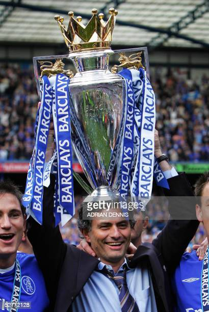 Chelsea's Manager Jose Mourinho holds aloft the Barclays Premiership trophy during the celebrations after the game against Charlton at Stamford...