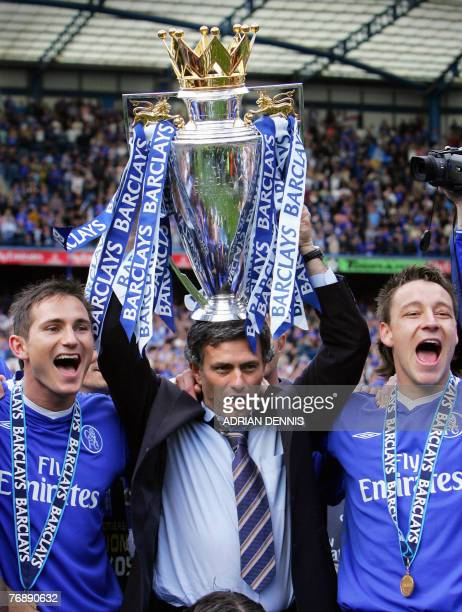Chelsea's Manager Jose Mourinho holds aloft the Barclays Premiership trophy beside Frank Lampard and John Terry during the celebrations after the...