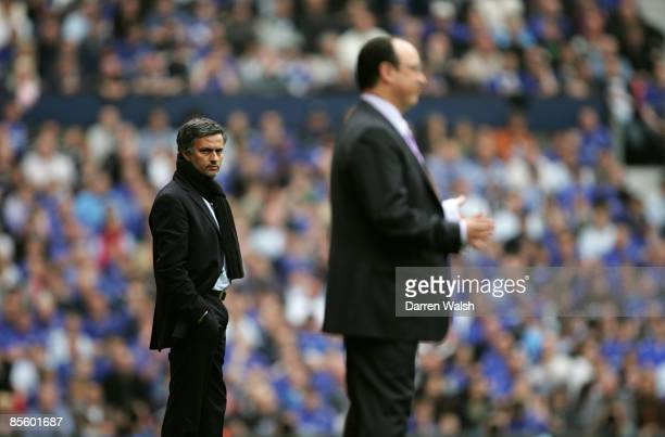 Chelsea's manager Jose Mourinho looks back at Liverpool manager Rafael Benitez