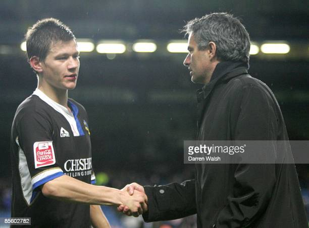 Chelsea's manager Jose Mourinho shakes hands with Macclesfield Town's James Jennings after the final whistle