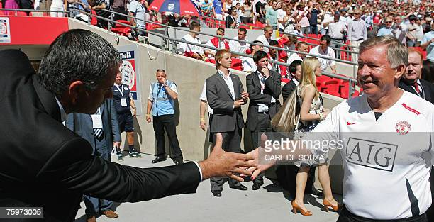 Chelsea's Manager Jose Mourinho shakes hands with Manchester United's Manager Alex Ferguson before their FA Community Shield match football match at...