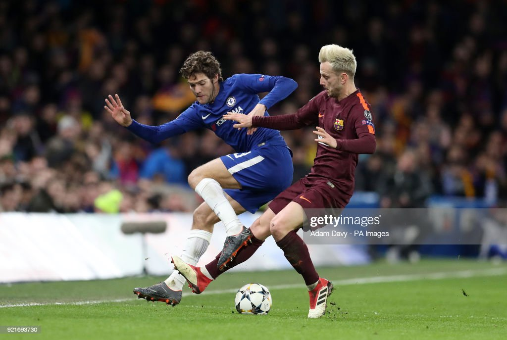 Chelsea's Marcos Alonso and Barcelona's Ivan Rakitic battle for the ball during the UEFA Champions League round of sixteen, first leg match at Stamford Bridge, London.