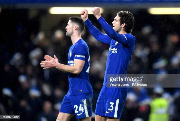 Chelsea's Marcos Alonso and Chelsea's Gary Cahill celebrate after the final whistle during the Premier League match at Stamford Bridge London