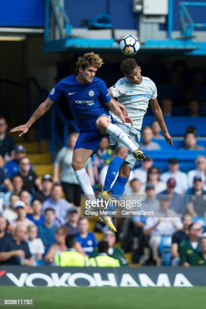 Chelsea's Marcos Alonso battles for possession with Everton's Mason Holgate during the Premier League match between Chelsea and Everton at Stamford...