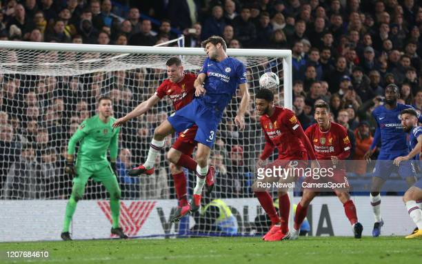 Chelsea's Marcos Alonso challenges with Liverpool's James Milner and Joe Gomez during the FA Cup Fifth Round match between Chelsea and Liverpool at...