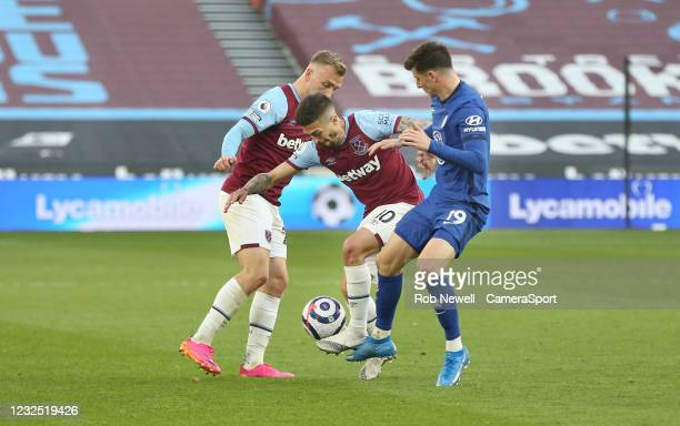 Chelsea's Mason Mount challenges West Ham United's Manuel Lanzini and Jarrod Bowen during the Premier League match between West Ham United and...