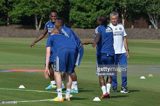 Chelsea's Michael Essien Nathaniel Chalobah Victor Moses Jose Mourinho during pre season training at Cobham Training Ground on 8th July 2013 in...