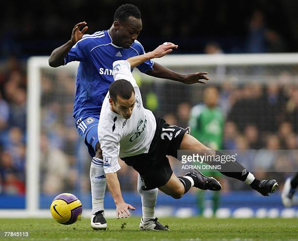 Chelsea's Michael Essien vies for the ball against Everton's Leon Osman during their Premiership football match at Stamford Bridge in London 11...