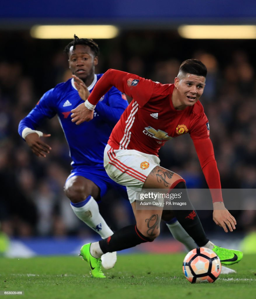 Chelsea's Michy Batshuayi and Manchester United's Marcos Rojo during the Emirates FA Cup, Quarter Final match at Stamford Bridge, London.