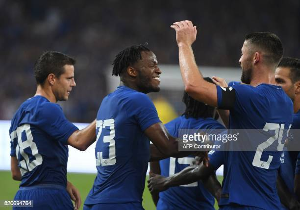 Chelsea's Michy Batshuayi celebrates with Gary Cahill and Cesar Azpilicueta after scoring against Arsenal during their preseason football match in...