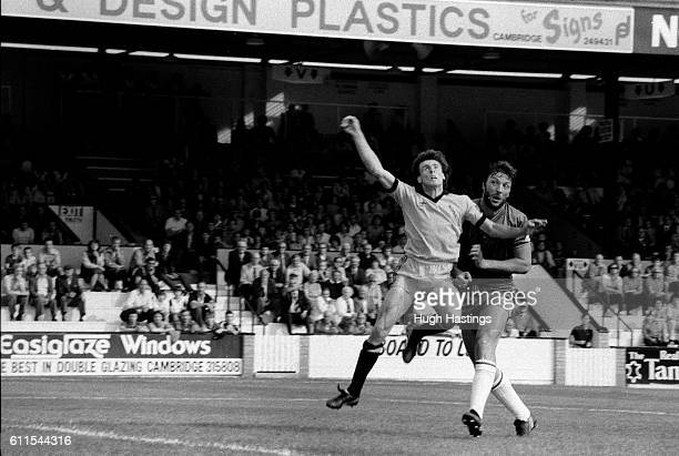 Chelsea's Micky Droy puts the home team's defence under pressure.