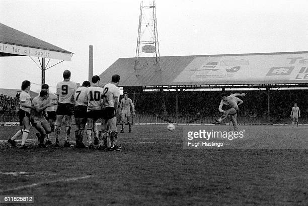 Chelsea's Micky Fillery takes a freekick on the Bolton goal