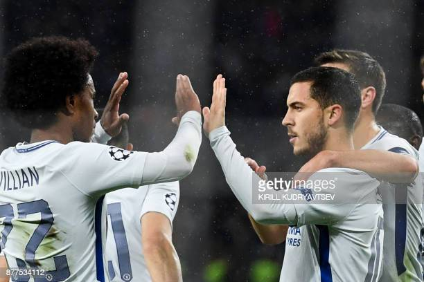 Chelsea's midfielder from Belgium Eden Hazard celebrates after scoring a goal from the penalty spot during the UEFA Champions League Group C football...