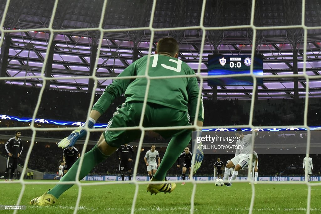 Chelsea's midfielder from Belgium Eden Hazard shoots to score the team's first goal from the penalty spot during the UEFA Champions League Group C football match between Qarabag FK and Chelsea FC in Baku on November 22, 2017. / AFP PHOTO / Kirill KUDRYAVTSEV