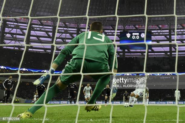 Chelsea's midfielder from Belgium Eden Hazard shoots to score the team's first goal from the penalty spot during the UEFA Champions League Group C...