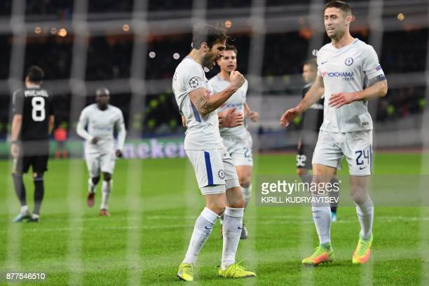 Chelsea's midfielder from Spain Francesc Fabregas celebrates after scoring the team's third goal from the penalty spot during the UEFA Champions...