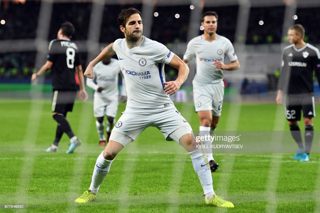 Chelsea's midfielder from Spain Francesc Fabregas (C) celebrates after scoring the team's third goal from the penalty spot during the UEFA Champions League Group C football match between Qarabag FK and Chelsea FC in Baku on November 22, 2017. / AFP PHOTO / Kirill KUDRYAVTSEV