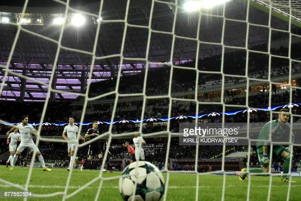 Chelsea's midfielder from Spain Francesc Fabregas celebrates after scoring the team's third goal from the penalty spot as Qarabag's goalkeeper from...