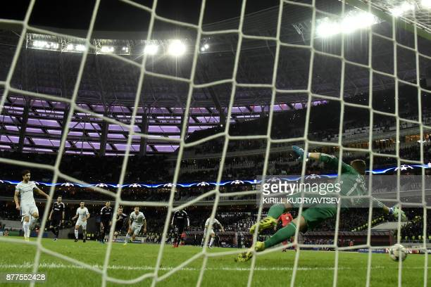 Chelsea's midfielder from Spain Francesc Fabregas scores the team's third goal from the penalty spot during the UEFA Champions League Group C...