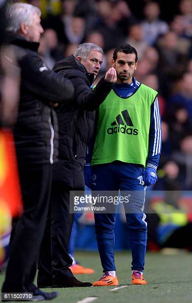 Chelsea's Mohamed Salah receives instructions from manager Jose Mourinho on the touchline