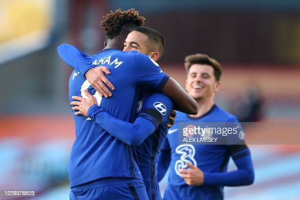 Chelsea's Moroccan midfielder Hakim Ziyech embraces Chelsea's English striker Tammy Abraham after scoring the opening goal during the English Premier...